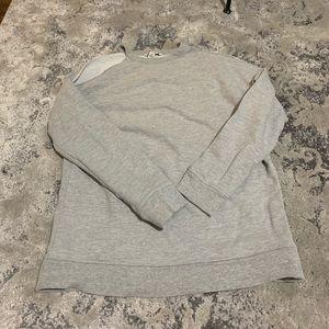 Grey longsleve shirt.